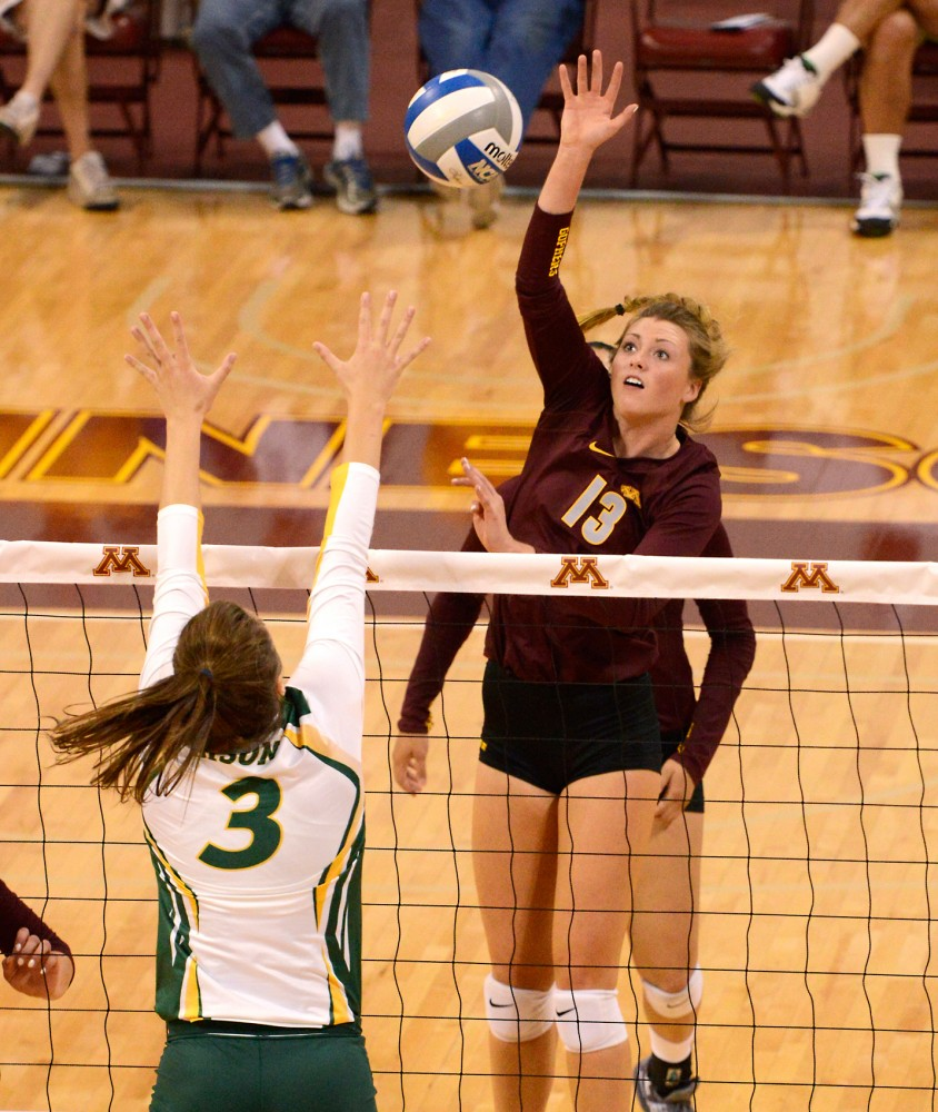 Sophomore Molly Lohman strikes the ball at the Sports Pavilion on Saturday morning, where the Gophers defeated North Dakota State University.