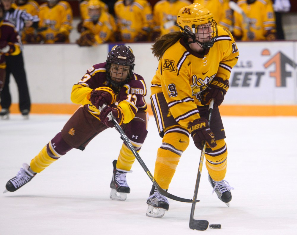 Gophers forward Kelly Pannek drives the puck just seconds before her second period goal against the Bulldogs at Ridder Arena on Saturday, October 24.