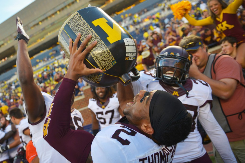 Gophers defensive back Cedric Thompson pretends to drink from the Little Brown Jug after beating Michigan 30-14 on Sept. 27, 2015.