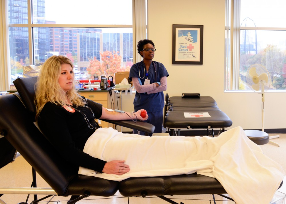 Minneapolis resident Jana Antony donates blood in the Red Cross Minneapolis Donation Center on Friday, where bags of blood are processed, tested, and sold to a hospital for an average of $219 each.