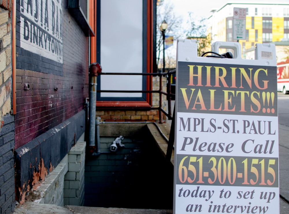 Loring Pasta Bar displays a hiring sign on Monday in Dinkytown. Many businesses are forced hire more students mid-semester as students leave their jobs to focus on school.