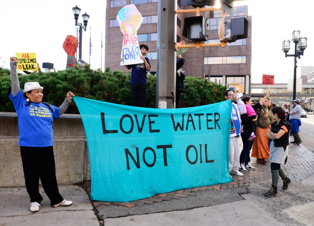 Demonstrators from non-profit organization Honor the Earth occupy the corner of Lake Ave. and Superior St. in Duluth, MN on Monday afternoon. The demonstration took place in order to voice opposition to the expansion of Enbridge Energy oil pipelines in the Great Lakes region.