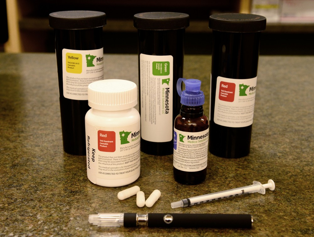 Demonstration cannabis derived medication on display in the Minnesota Medical Solutions building on Monday morning. Medications are labeled with different colors that denote varying concentrations of cannabinoids used to treat certain medical conditions.
