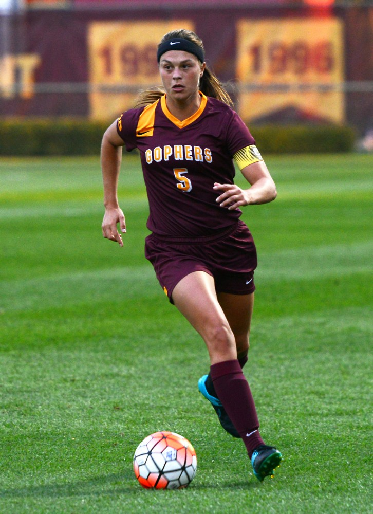 Senior Haley Helverson dribbles the ball down the field at Elizabeth Lyle Robbie Stadium on Friday, Sept. 11.