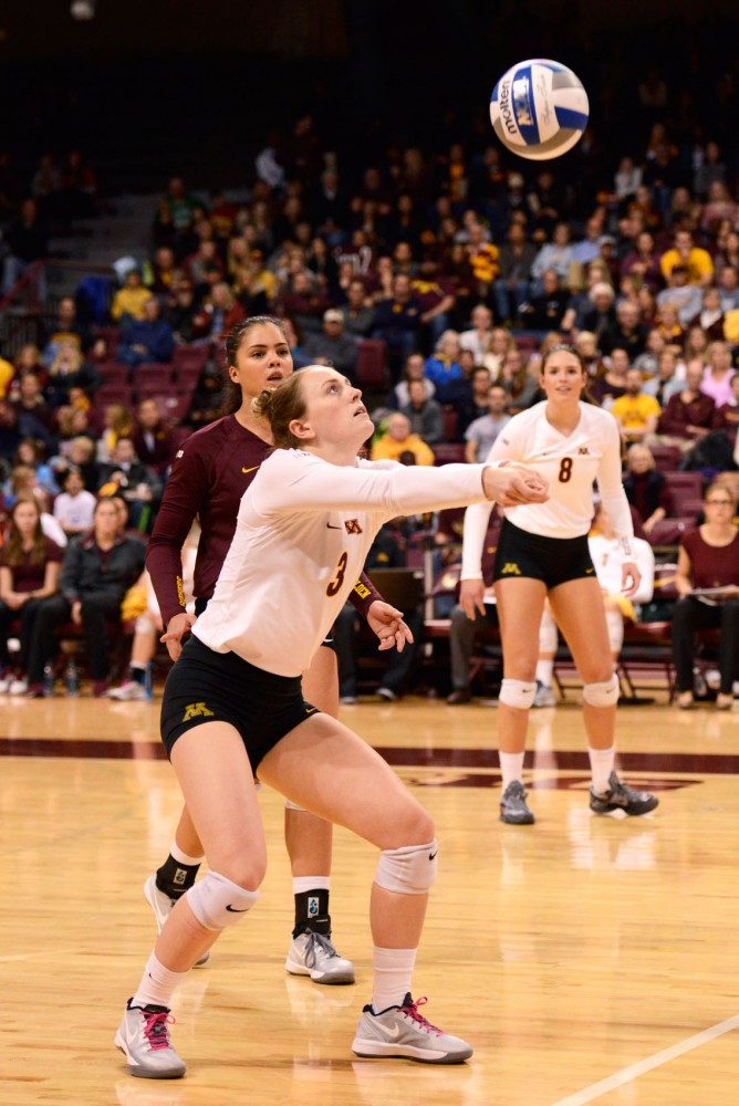 Setter Katie Schau bumps the ball while playing against Indiana in the Sports Pavilion on Oct. 28, 2015.