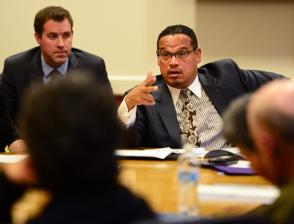 Representative Keith Ellison speaks with a round table of University faculty members on their struggles with research funding in Coffman Memorial Union on Thursday.