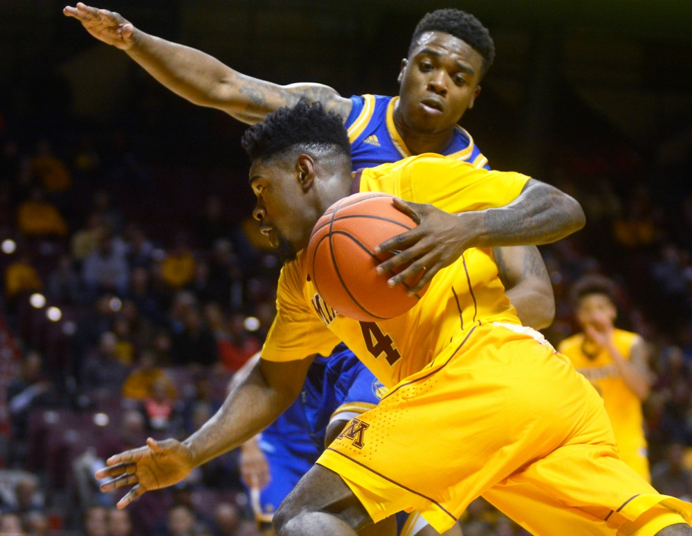Kevin Dorsey drives towards the basket Friday evening at Williams Arena where the Gophers defeated UMKC 76-58.