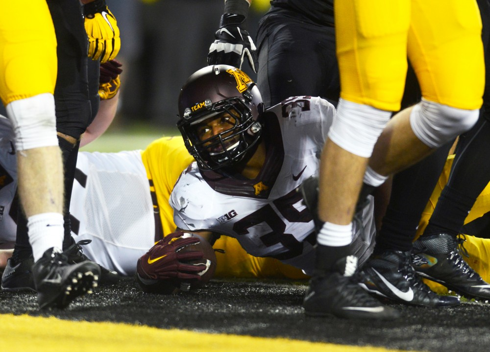 Running back Rodrick Williams Jr. lands in the end zone, scoring a touchdown in the third quarter at Kinnick Stadium in Iowa City, IA, on Saturday Oct. 14 where the Gophers lost to the Hawkeyes 35-40.