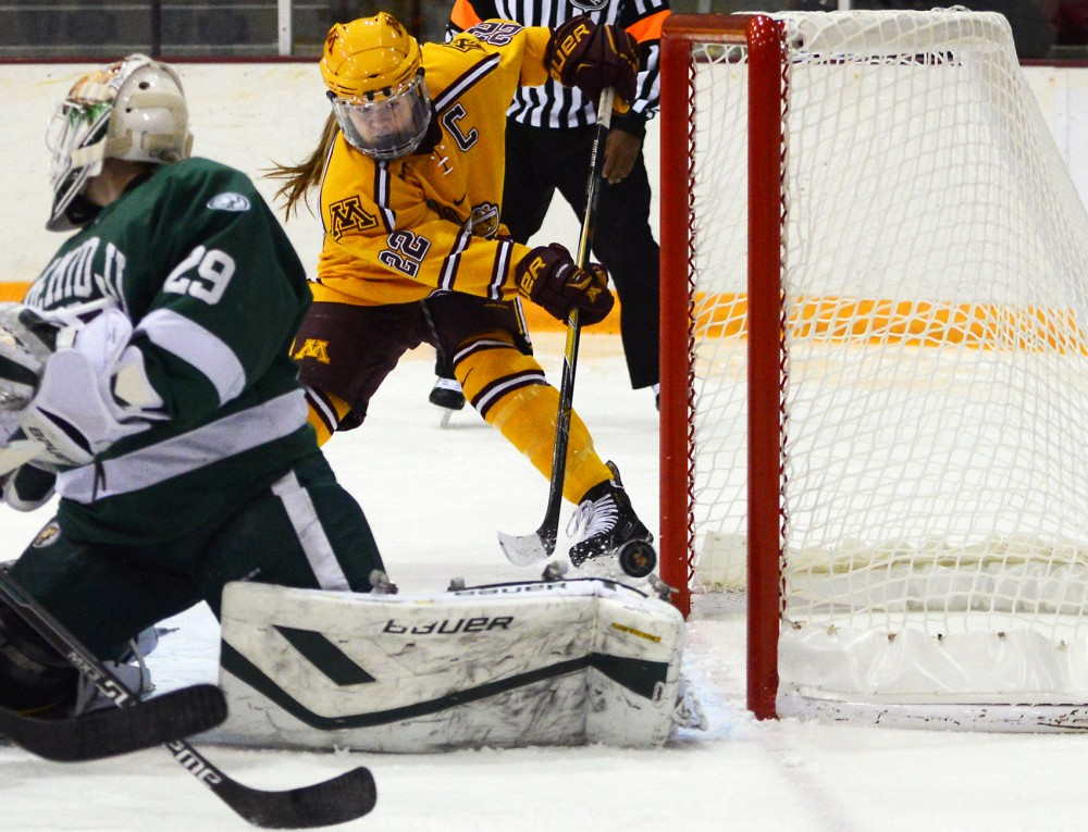 Senior forward Hannah Brandt scores at Ridder Arena on Saturday, where the Gophers defeated Bemidji State 8-3. Brandt scored five goals, including her 100th career goal, and earned the title of Gopher womens hockeys all-time career leading scorer.