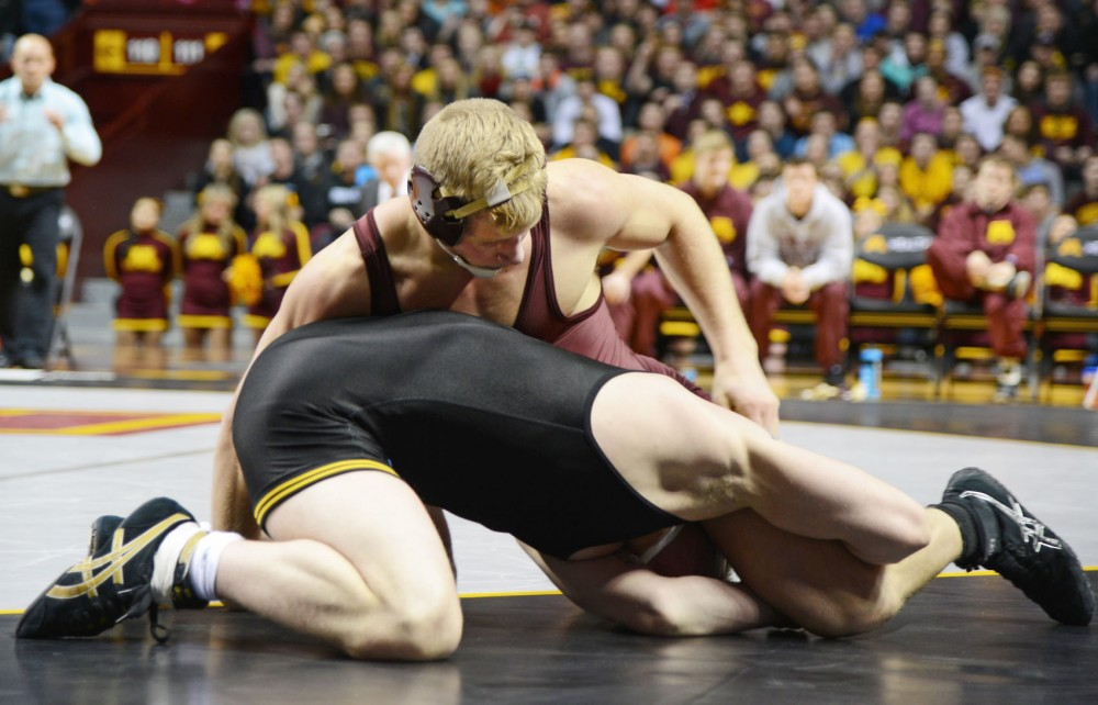 Brett Pfarr wrestles during a match in Williams Arena on Jan. 30, where the Gophers competed against the Iowa Hawkeyes.