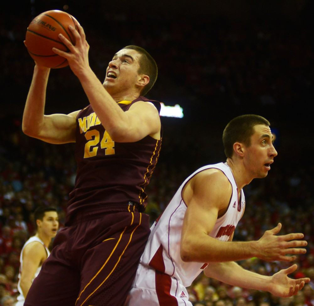 Minnesota forward Joey King shoots the ball in the second half against the Badgers on Saturday, Feb. 21.