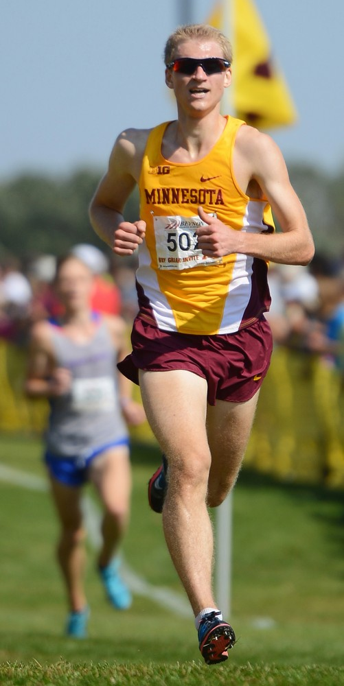Aaron Bartnik runs the final stretch of the Roy Griak Invitational at Les Bolstad Golf Course on Sept. 27.
