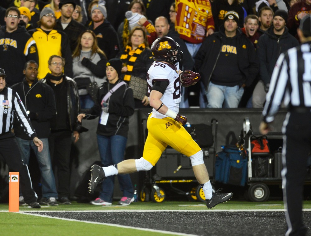 Tight end Brandon Lignen crosses into the end zone, scoring a touchdown in the second quarter at Kinnick Stadium in Iowa City, Iowa on Oct. 14 where the Gophers lost to the Hawkeyes 35-40.