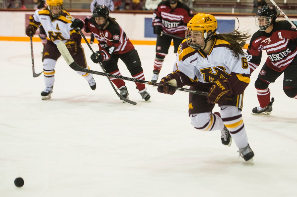 Gophers forward Kate Schipper chases down the puck during the second period against St. Cloud State on Feb. 28, 2014.