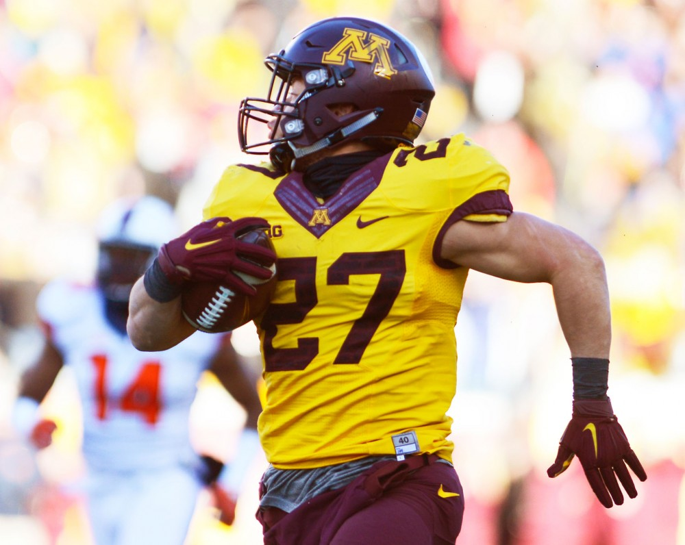 Gophers running back Shannon Brooks runs for a 75-yard touchdown late in the fourth quarter on Saturday at TCF Bank Stadium where Minnesota defeated Illinois 32-23. The touchdown, followed by a 2-point conversion took the gophers up 8 points, giving them a more comfortable lead.