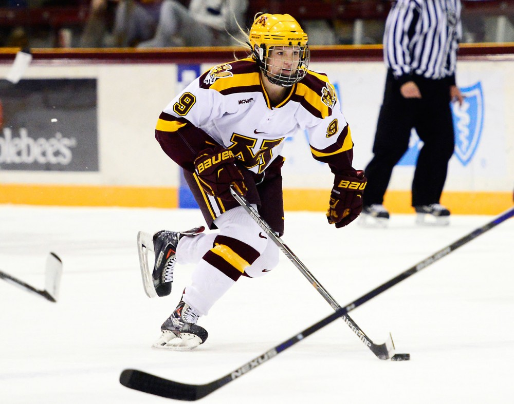 Gophers defense Sydney Baldwin maneuvers the puck towards the net at Ridders Arena on Friday night where Minnesota defeated Yale.