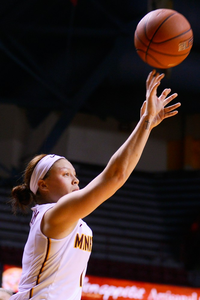 Rachel Banham shoots from the perimeter on Friday night at Williams Arena where the Gophers defeated Maine 91-64.