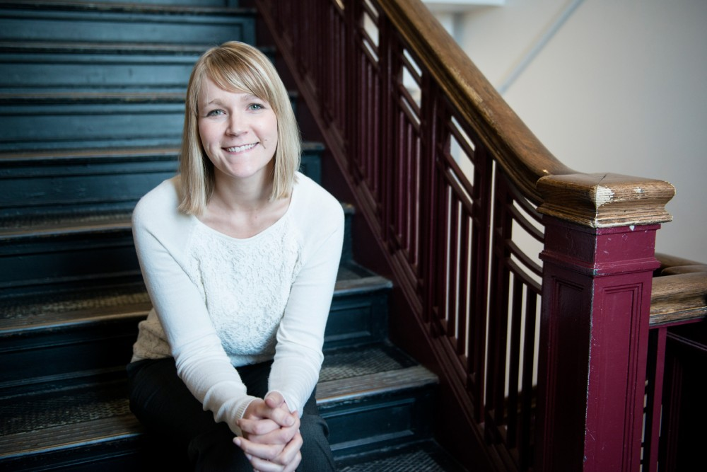 The Aurora Center's newly appointed Men's Engagement Coordinator Jeni Kolb poses for portraits inside Appleby Hall on Tuesday.