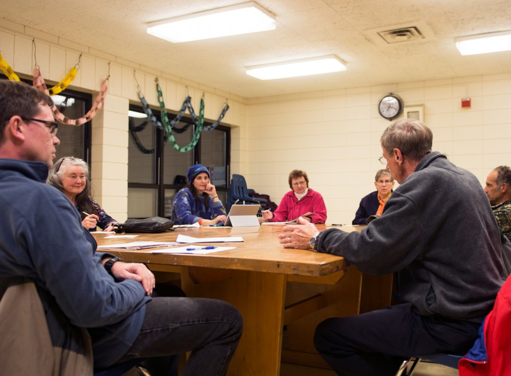 Members of SECIA, the Southeast Como Improvement Association, meet at Van Cleve Park on Tuesday. University of Minnesota Graduate and Professional Student Assembly member Hilary Lovelace, not pictured, was recently elected to a full-board position within the organization.