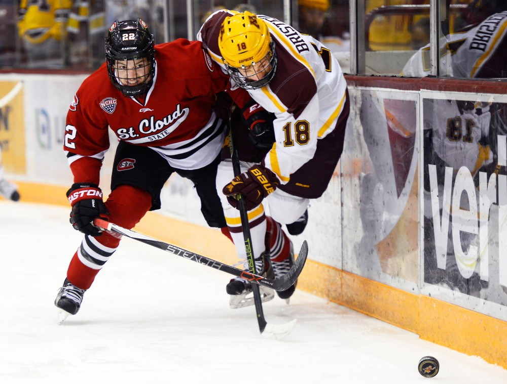 Gophers forward Leon Bristedt struggles to hold the puck against St. Cloud State defender Jimmy Schuldt at Mariucci Arena on Friday.