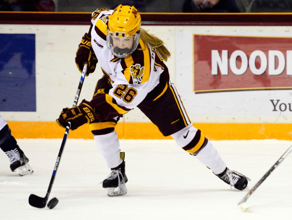 Gophers forward Sarah Potomak maneuvers the puck away from Yale at Ridders Arena on Nov. 20, 2015.