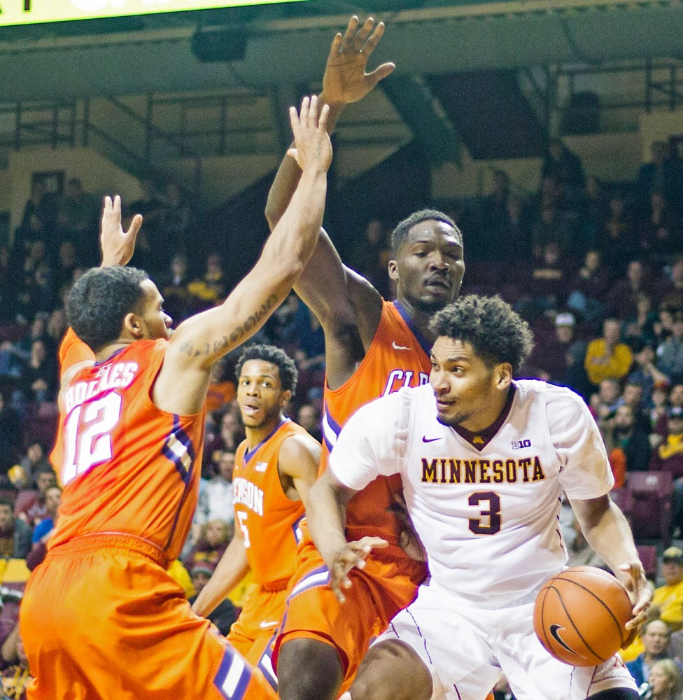 Gophers forward Jordan Murphy handles the ball around the Clemson Tigers in William's Arena on Monday night.