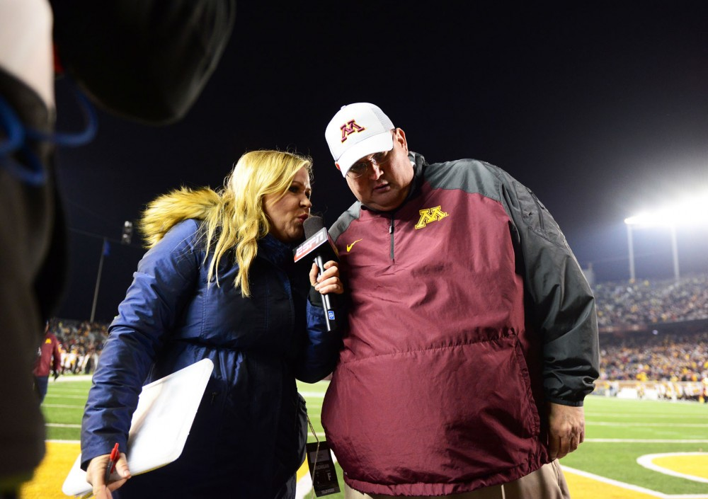 Tracy Claeys stops for a brief interview on his way off of the field for halftime at TCF Bank Stadium on Oct. 31, when the Wolverines defeated the Gophers 29-26.
