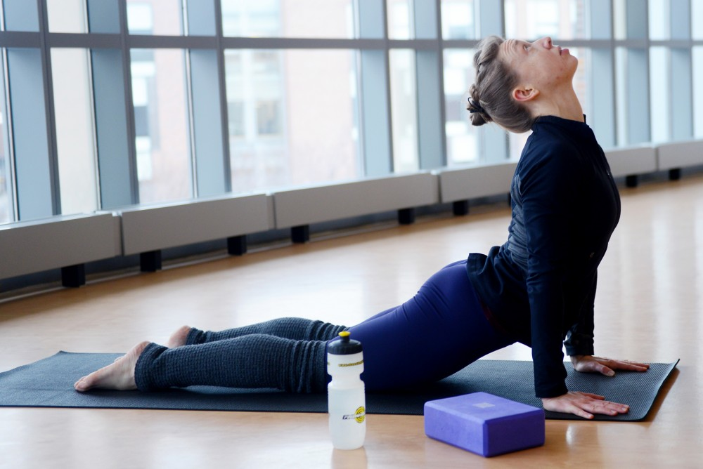 Ariel Linnerson instructs an advanced yoga class at the Recreation and Wellness Center on Tuesday. In Spring of 2016, the University of Minnesota will be offering courses that give students the chance to become certified yoga instructors.
