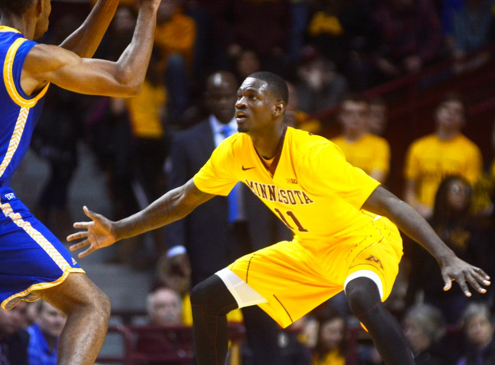 Gophers guard Carlos Morris plays defense at Williams Arena on Nov. 13.