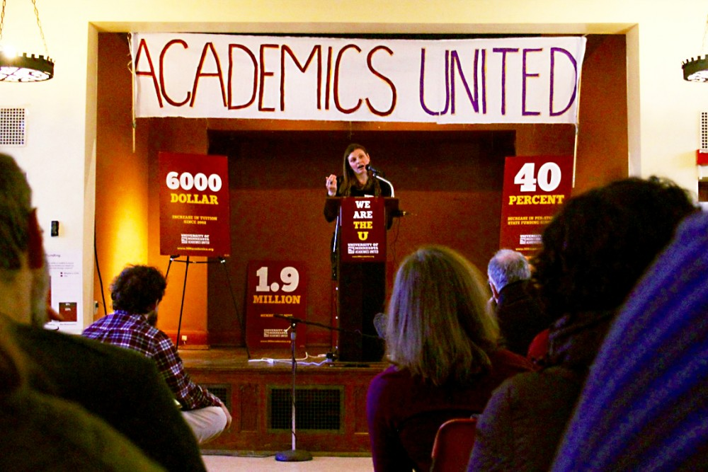 Graduate student Courtney Gildersleeve speaks at the University Baptist Church in Dinkytown on Thursday, where people gathered, calling for Minnesotas surplus funds to be spent on education.