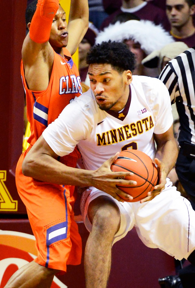 Gophers forward Jordan Murphy moves the ball around the Clemons Tigers in William's Arena on Monday, Nov. 11.