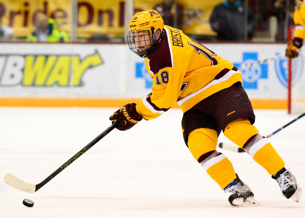 Gophers forward Leon Bristedt maneuvers the puck down the rink at Mariucci Arena on Saturday during Minnesota's game against Ohio State.