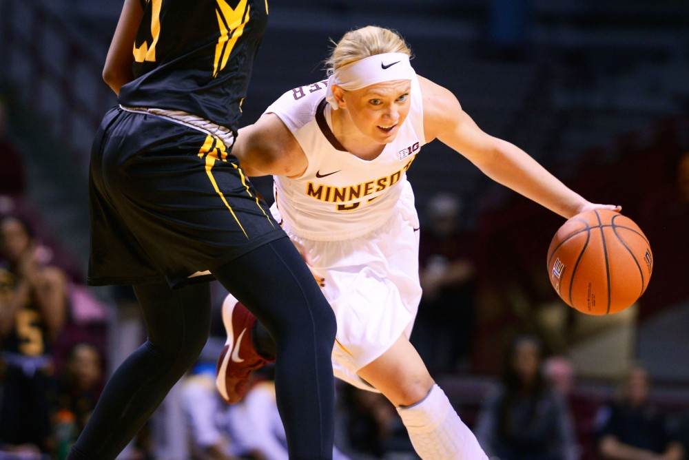 Minnesota guard Carlie Wagner drives the ball down the court at Williams Arena where the Gophers defeated the Towson Tigers 105-86. Wagner was one of three Gophers to earn a double-double by the game's end.