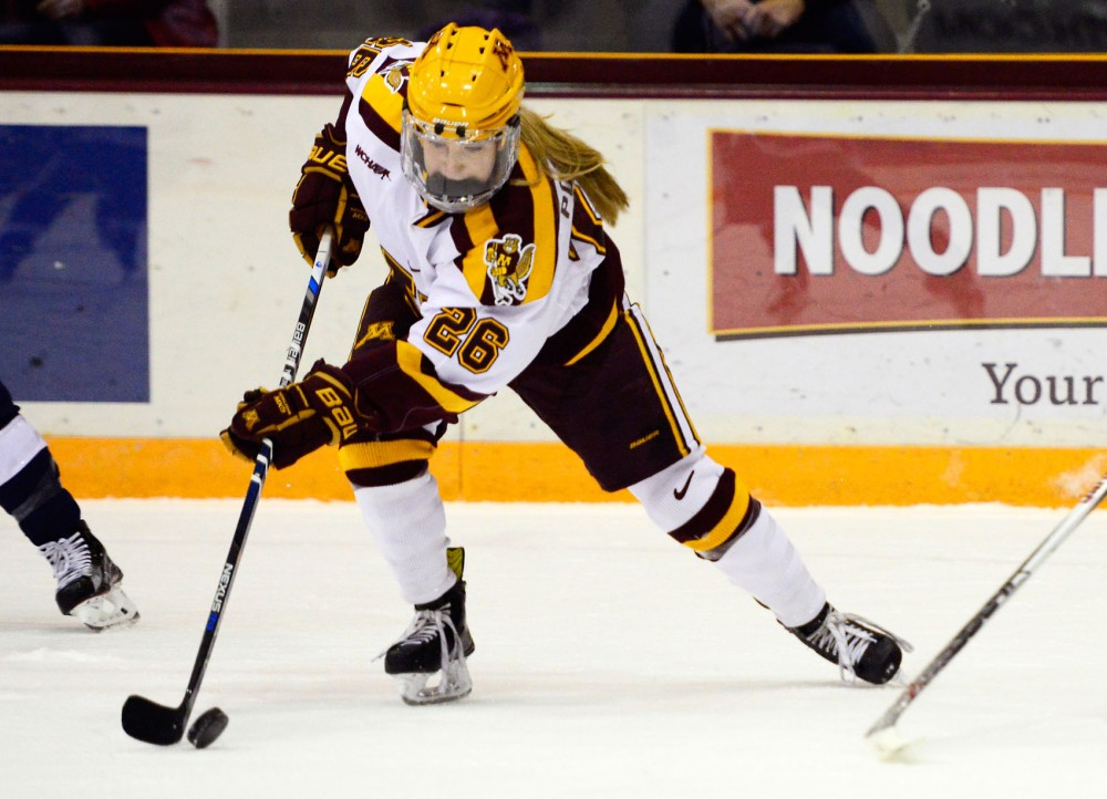 Gophers forward Sarah Potomak maneuvers the puck away from Yale in Ridders Arena on Nov. 20.