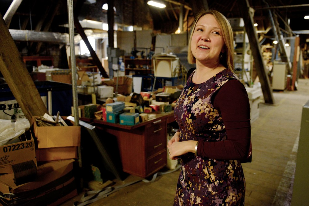 Space Planner at the University of Minnesota Anika Carlsted leads a tour of the Pillsbury Hall attic, a space that will be renovated with money from the 2016 capital request.