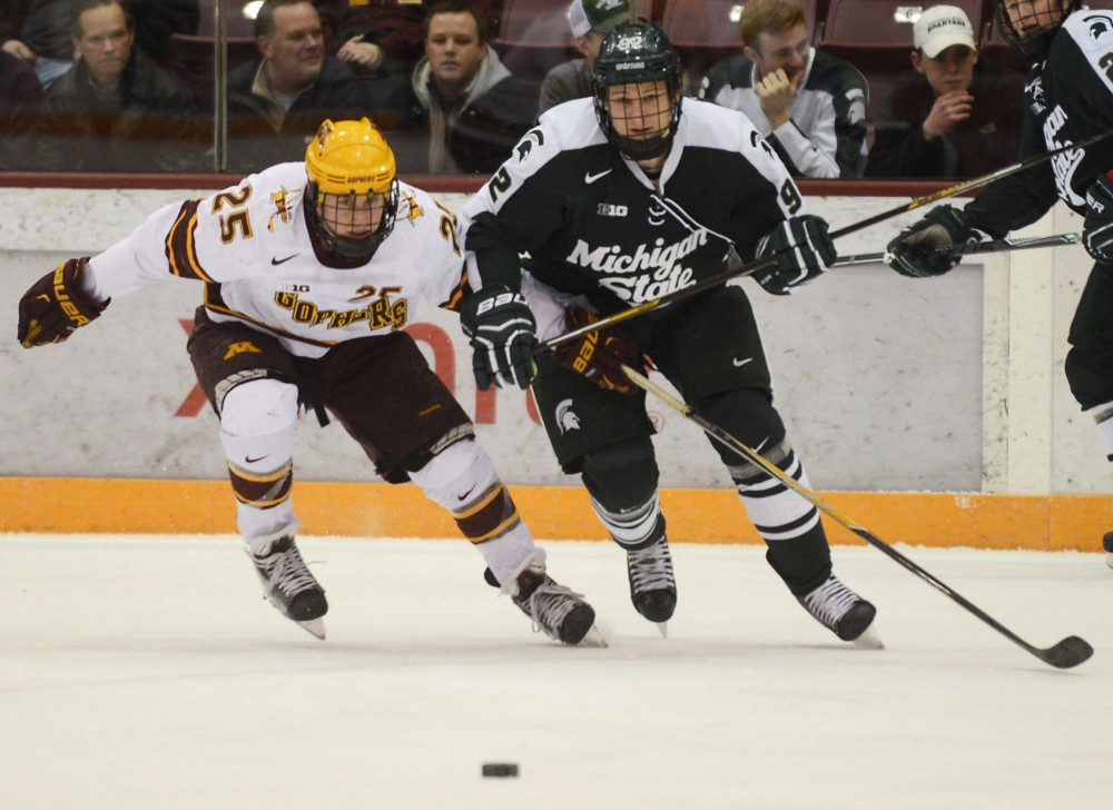 Minnesota forward Justin Kloos races to the puck in the first period against Michigan State University at Mariucci Arena on Feb. 26.