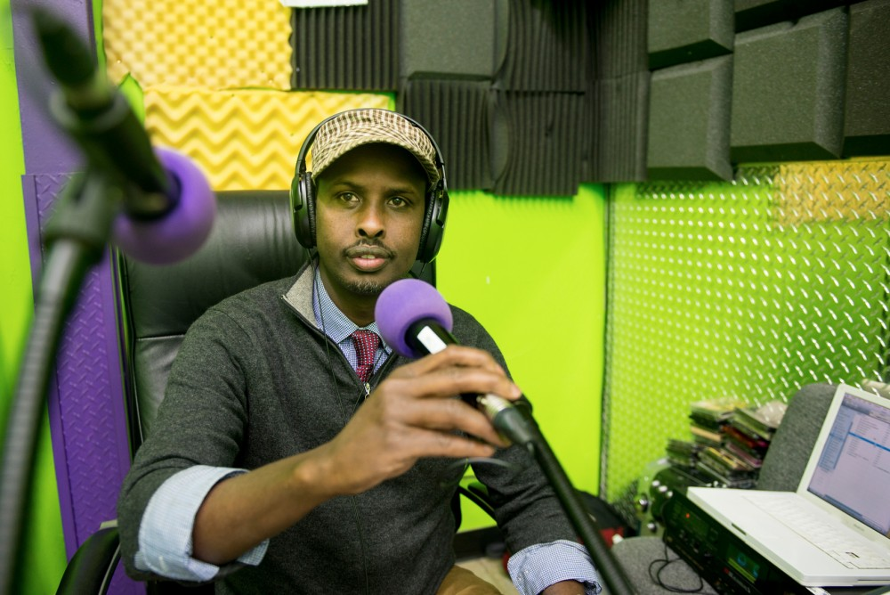 Radio KALY Executive Director Mahamed Cali poses for a portrait in between on-air takes in south Minneapolis on Wednesday. Broadcasting on 101.7FM, KALY is the first Somali-American radio station, looking to serve and further connect the Minneapolis Somali community.