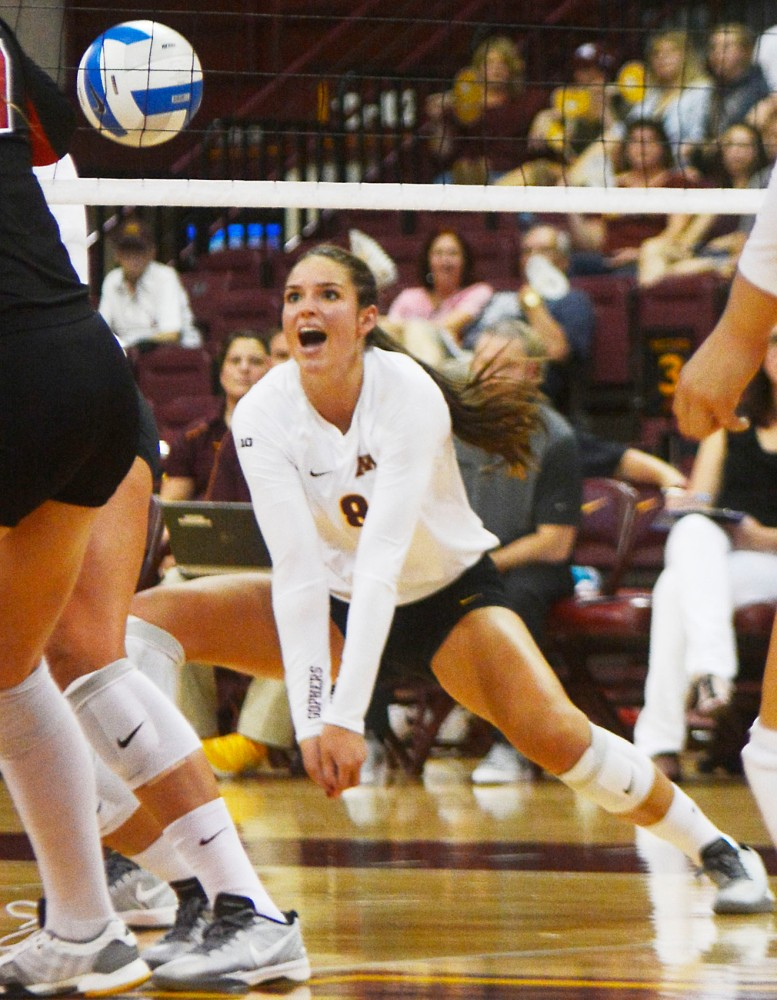 University of Minnesota outside hitter Sarah Wilhite lunges for the ball on Aug. 30, 2014 at the Sports Pavilion.