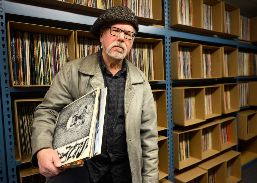 Writer and record collector Jon Bream stands with his 22,000-piece record collection. Bream sold the collection to Mill City Sound record store owner Rob Sheely last Spring, the proceeds of which will create a scholarship fund for University journalism students studying arts criticism.