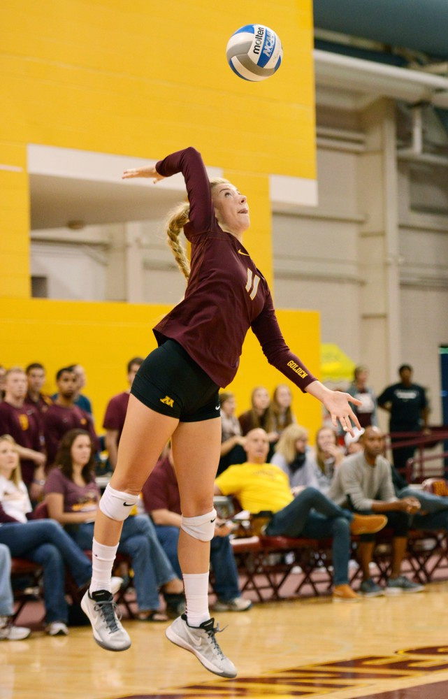 Minnesota freshman Samantha Seliger-Swenson serves the ball at the Sports Pavilion on Sept. 12.