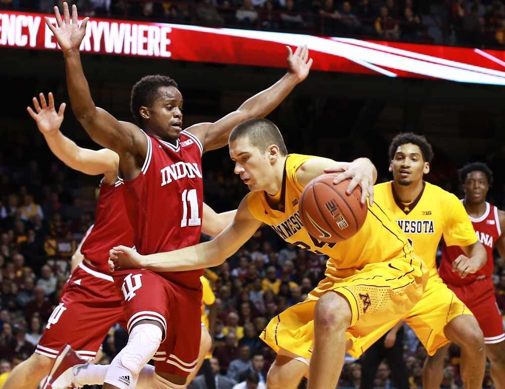 Minnesota forward Joey King pushes through Indiana's defense at Williams Arena on Saturday where the Gophers lost to the Hoosiers 70-63.