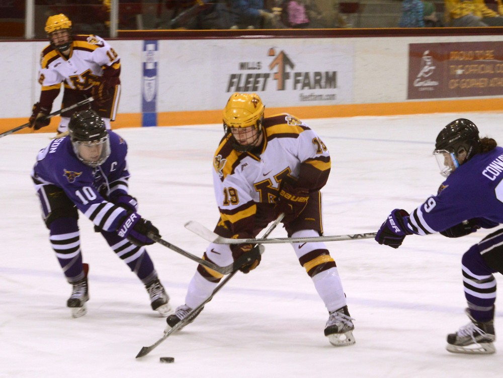 Minnesota forward Kelly Pannek fights for possession of the puck during second period against Minnesota State-Mankato at Ridder Arena on Saturday.