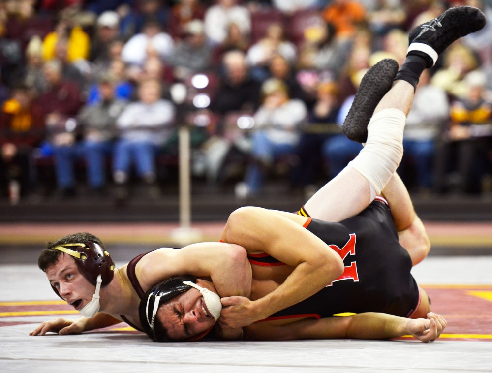 Brandon Kingsley overpowers Rutgers wrestler John Van Brill in the 157-pound weight class matchup at the Sports Pavilion on Sunday.