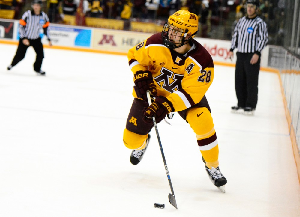 Gophers defense Jake Bischoff maneuvers the puck down the rink at Mariucci Arena on Dec. 5.