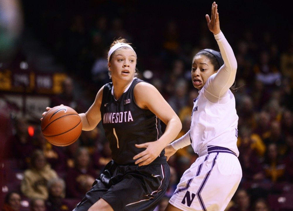 Minnesota guard Rachel Banham looks up court while shielding the ball from Northwestern guard Ashley Deary on Wednesday at Williams Arena where the Gophers won 95-92.