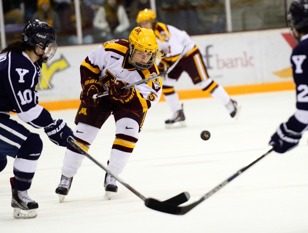 Gophers defense Sophie Skarzynski passes the puck down the rink while playing against Yale in Ridders Arena on Friday, Nov. 11, 2015.