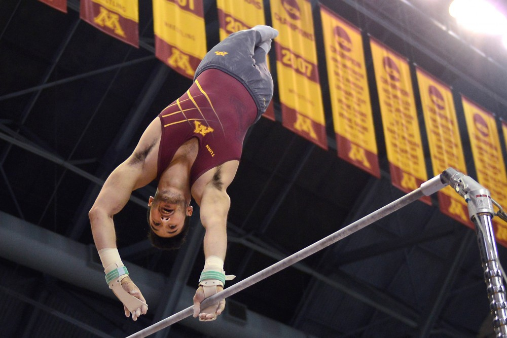 Junior Zach Liebler competes on the high bar at the Sports Pavilion on Saturday where Minnesota met with Penn State.