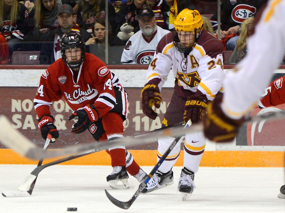 Gophers forward Hudson Fasching handles the puck against St. Cloud State at Mariucci Arena on Friday, Nov. 27, 2015.