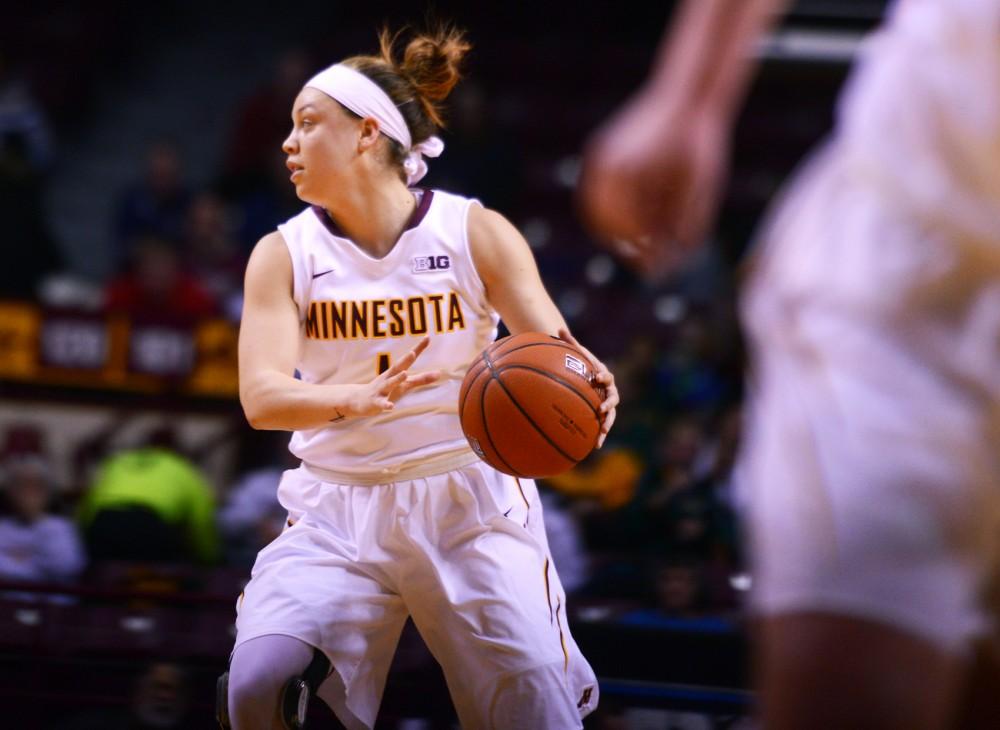Rachel Banham handles the ball at Williams Arena on Tuesday evening, where Minnesota defeated Illinois 82-77.