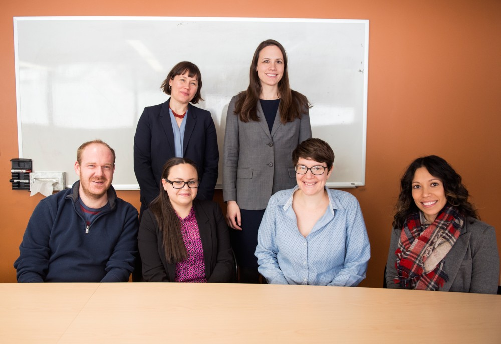 Lawyers Kate Evans, left, and Rebecca Scholtz pose for portraits with law students John Bruning, left, Nadia Anguiano-Wehde, Mary Georgevich and Alexandra De Leon in the University's law school on Tuesday. The students recently traveled to Dilley, Texas, and prevented the deportation of 12 immigrant families, who would have faced immediate harm if sent back.